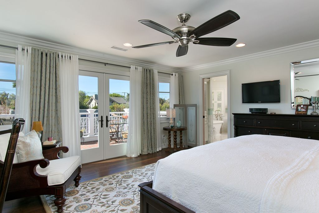 Traditional Master Bedroom with Standard height, Hardwood floors, Ceiling fan, can lights, double-hung window, French doors