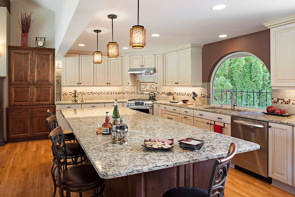 Mediterranean Kitchen with High ceiling, L-shaped, Wall Hood, Breakfast bar, Pendant light, dishwasher, Framed Partial Panel