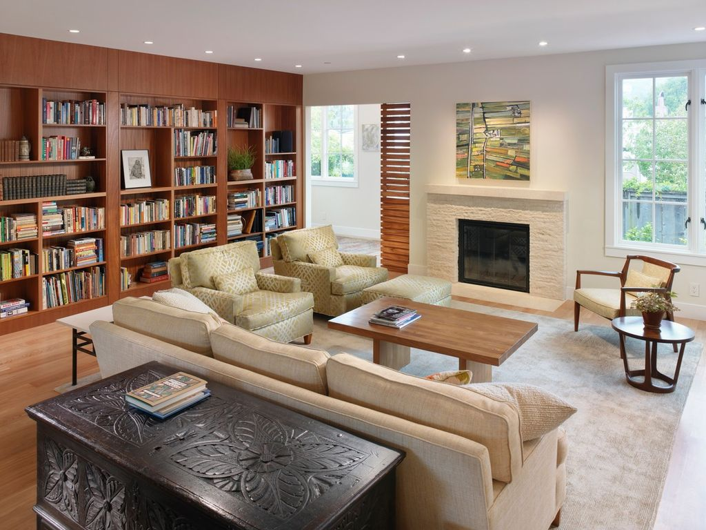 Contemporary Living Room with Casement, Cement fireplace, can lights, Standard height, Fireplace, Built-in bookshelf