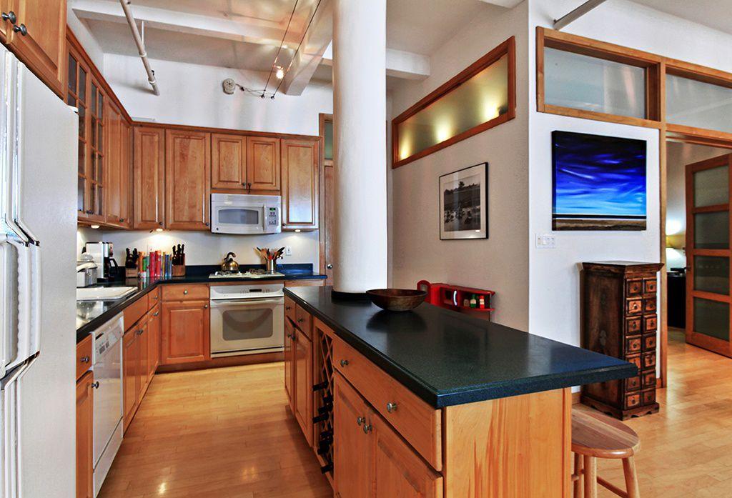 Modern Kitchen with High ceiling, Exposed beam, gas range, L-shaped, partial backsplash, Framed Partial Panel, dishwasher
