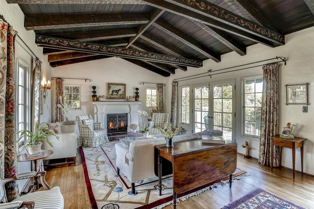 Traditional Living Room with Fireplace, Casement, French doors, Hardwood floors, High ceiling, Exposed beam, metal fireplace