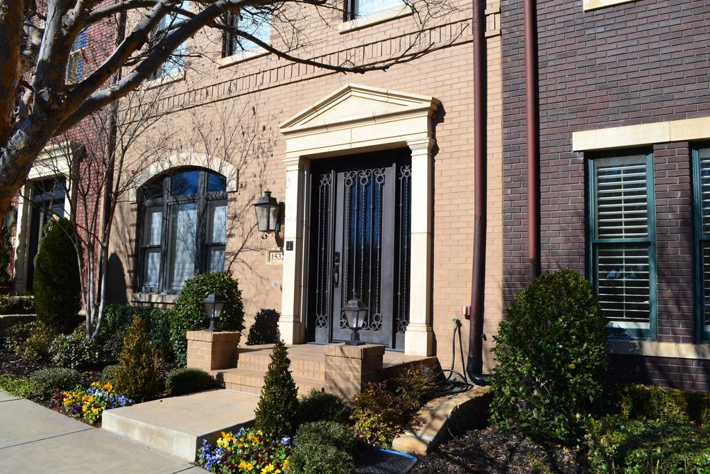 Traditional Exterior of Home with exterior tile floors, exterior brick floors, Glass panel door