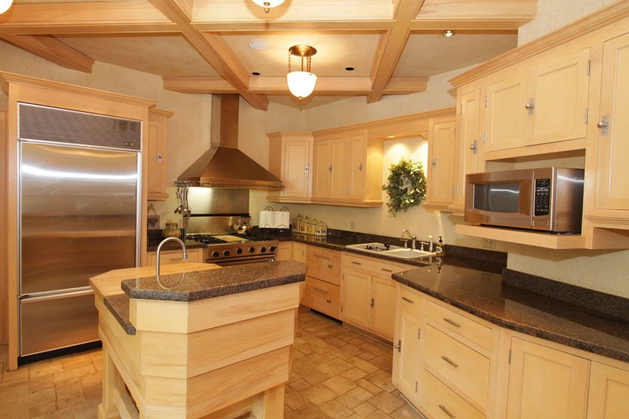 Contemporary Kitchen with can lights, limestone tile floors, Flat panel cabinets, Simple granite counters, gas range