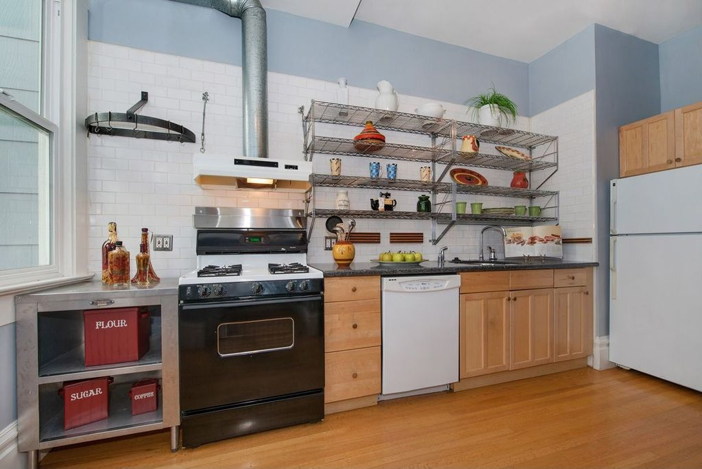 Eclectic Kitchen with Granite countertop, Paint 1, Simple granite counters, double-hung window, Flat panel cabinets, Flush
