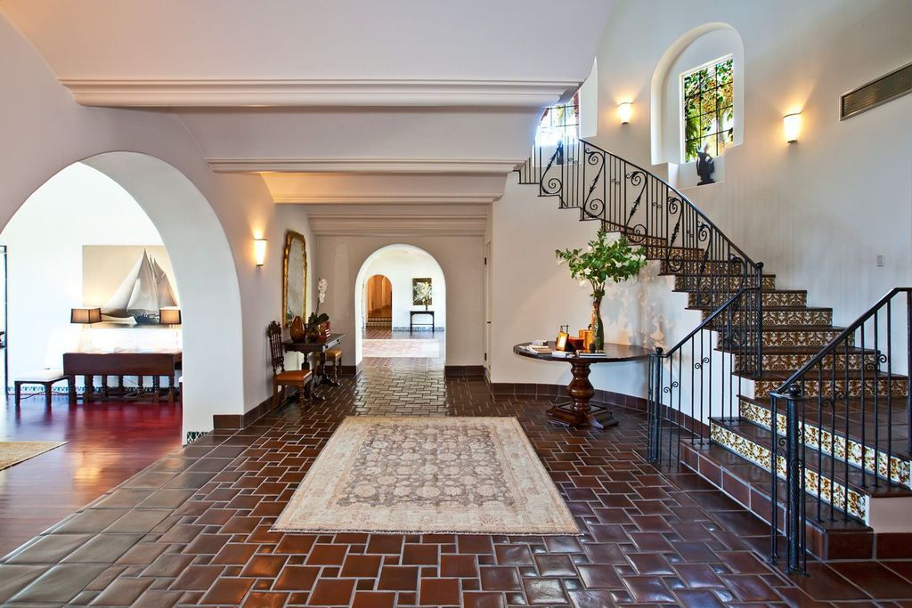 Eclectic Staircase with High ceiling, Arched window, terracotta tile floors, Wall sconce