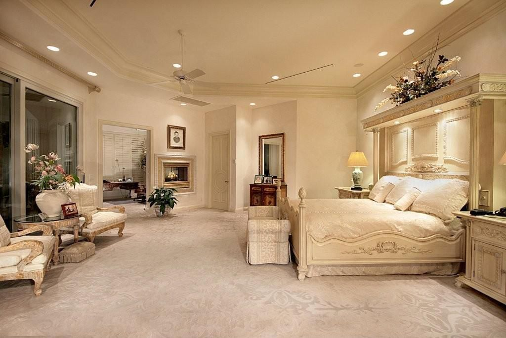 Traditional Guest Bedroom with can lights, Fireplace, picture window, insert fireplace, Carpet, six panel door