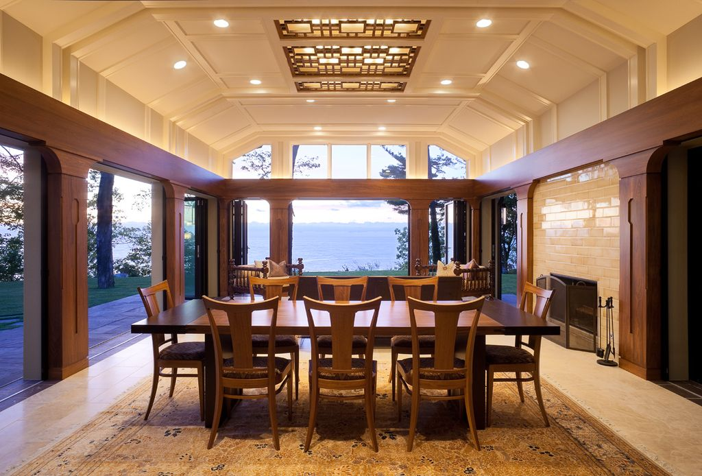 Contemporary Dining Room with Fireplace, insert fireplace, picture window, Columns, Casement, Box ceiling, sliding glass door