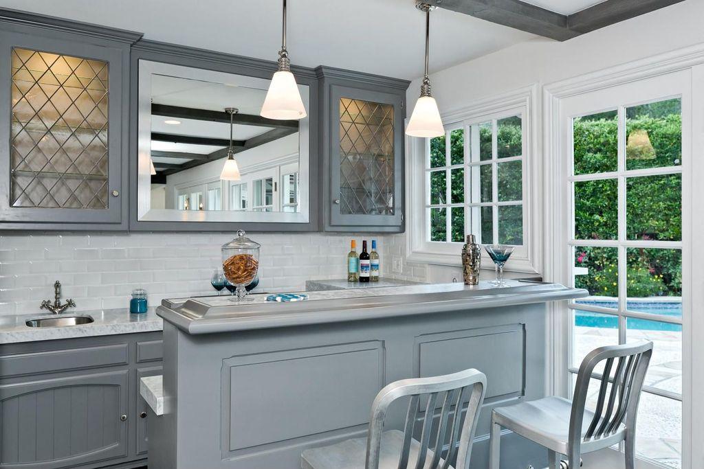 Traditional Bar with Standard height, Built-in bookshelf, Casement, Pendant light, Concrete floors, picture window