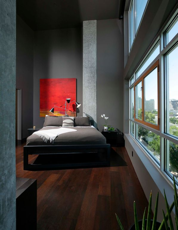 Modern Master Bedroom with picture window, High ceiling, interior wallpaper, can lights, Hardwood floors, Casement
