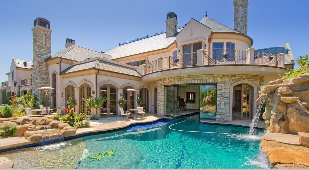 Mediterranean exterior of home with french doors arched - Attractive zillow home design ...