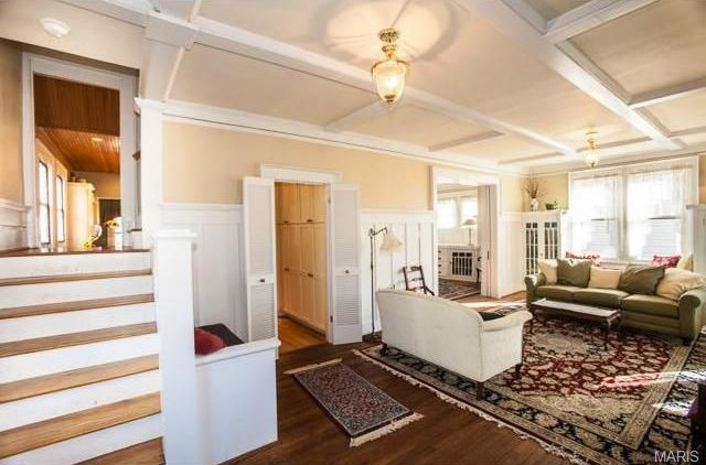 Traditional Living Room with Exposed beam, French doors, Crown molding, Wainscotting, Standard height, flush light