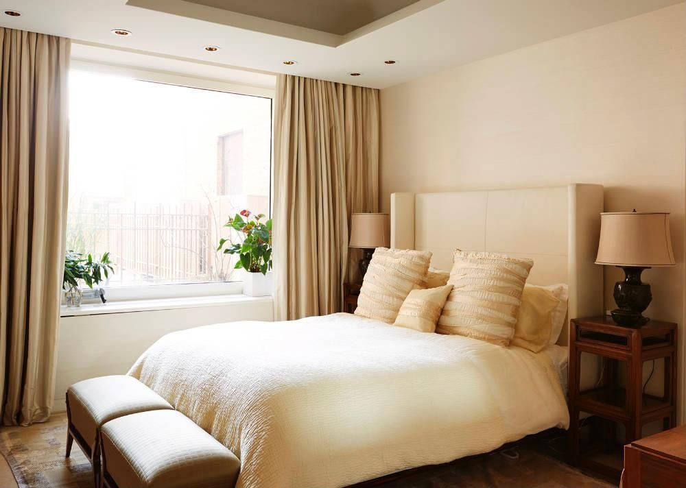 Contemporary Guest Bedroom with picture window, can lights, Standard height, Hardwood floors