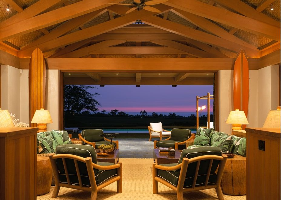 Tropical Living Room with Ceiling fan, Exposed beam, Carpet, Built-in bookshelf, Cathedral ceiling