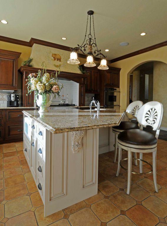 Mediterranean Kitchen with Kitchen island, Flat panel cabinets, Custom hood, Breakfast bar, Large Ceramic Tile, Galley