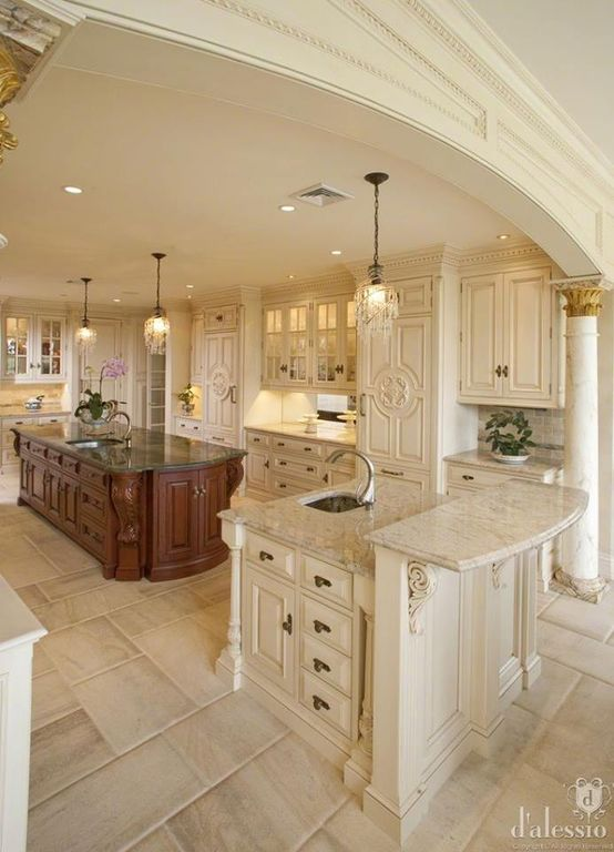 Traditional Kitchen with Armoire style refrigerator panel, Acanthus scroll corbel, French doors, stone tile floors, U-shaped