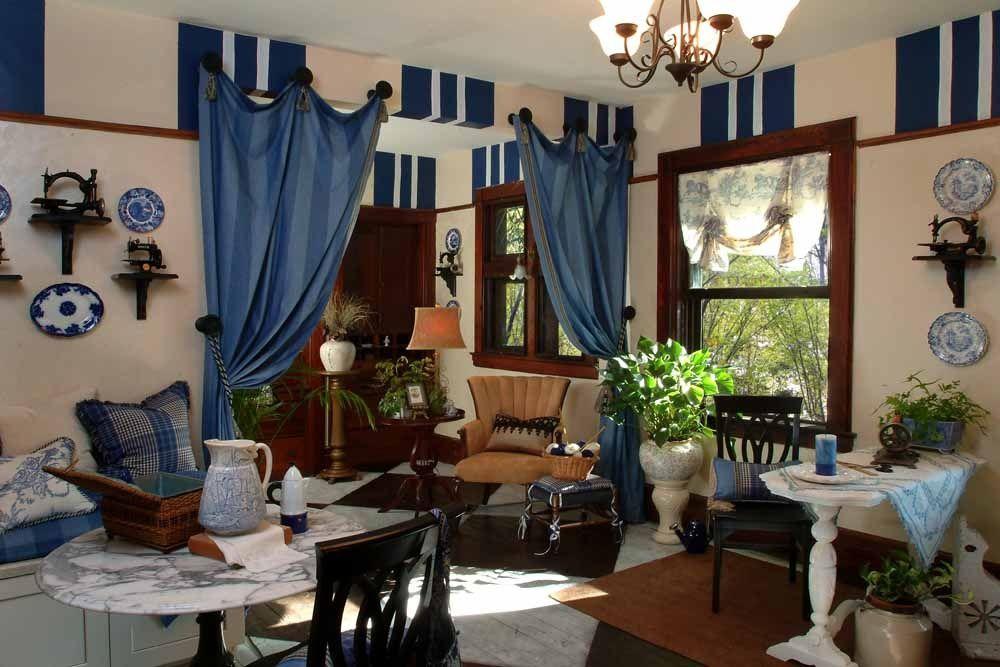 Eclectic Living Room with interior wallpaper, Exposed beam, Carpet, Built-in bookshelf, Chandelier