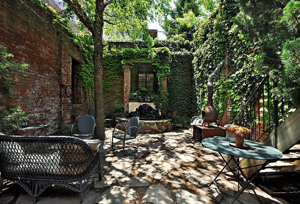 Traditional Patio with Fence, Wicker lane wicker patio loveseat, Pangaea round iron folding patio dining table, Casement
