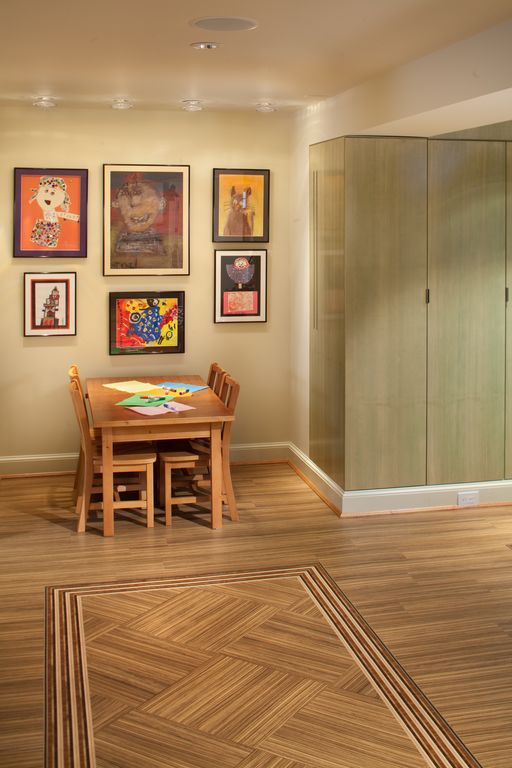 Contemporary Playroom with Standard height, can lights, Laminate floors
