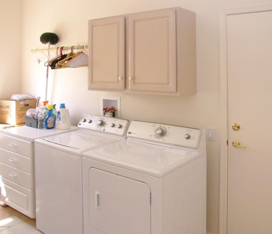 Traditional Laundry Room with laundry sink, flat door, Hanging Bar, drop-in sink, limestone tile floors, Built-in bookshelf