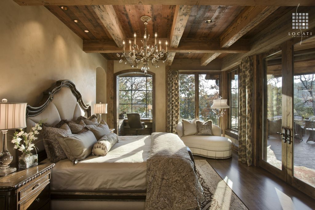 Country Master Bedroom with can lights, Laminate floors, Casement, Standard height, Window seat, Chandelier, Exposed beam