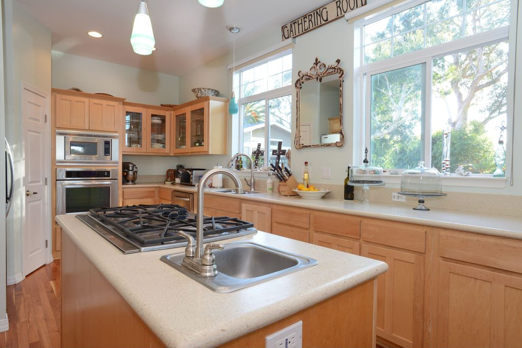 Traditional Kitchen with flush light, Inset cabinets, specialty door, Pendant light, Kitchen island, built-in microwave