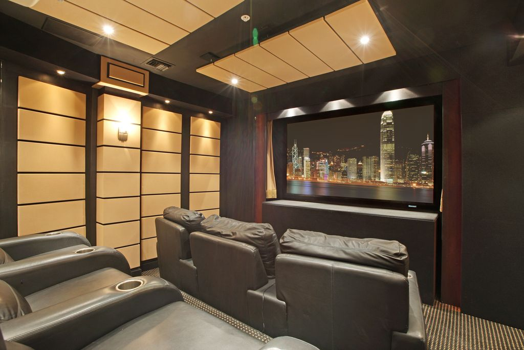 Contemporary Home Theater with can lights, Standard height, Carpet, Wall sconce