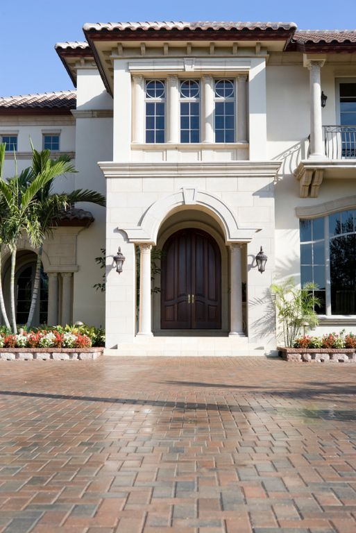 Mediterranean front door with exterior brick floors by for Affordable furniture jennings la