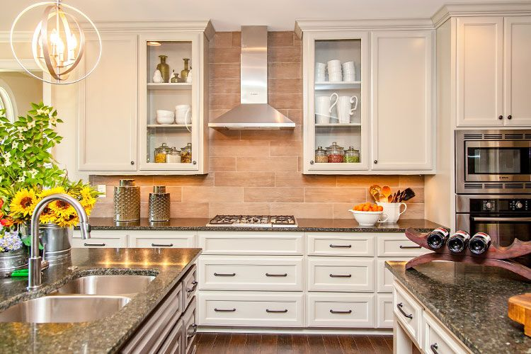 Traditional Kitchen with electric cooktop, Multiple Sinks, Wall Hood, wall oven, flush light, full backsplash, Raised panel