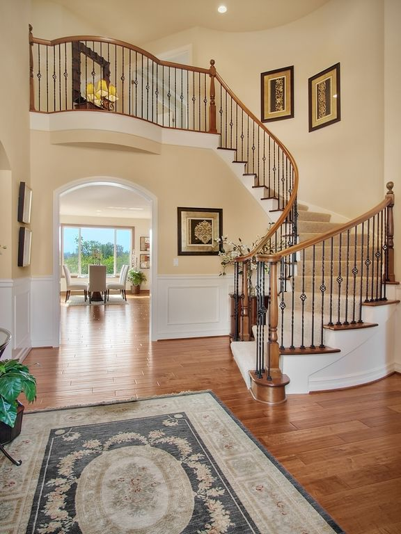 Traditional Entryway with Balcony, Wainscotting, High ceiling, Hardwood floors