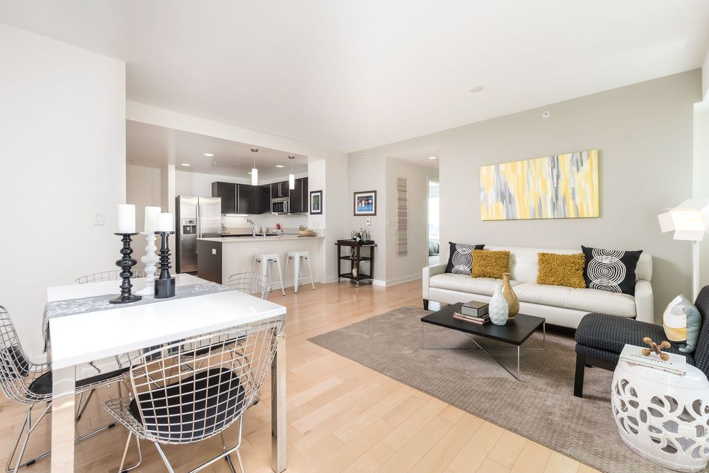 Contemporary Great Room with can lights, Built-in bookshelf, Hardwood floors, Standard height, Pendant light