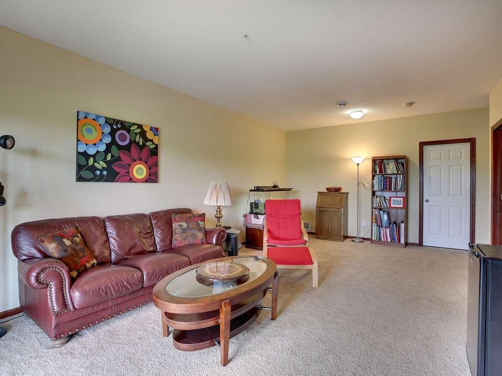 Craftsman Living Room with six panel door, Carpet, flush light, Standard height