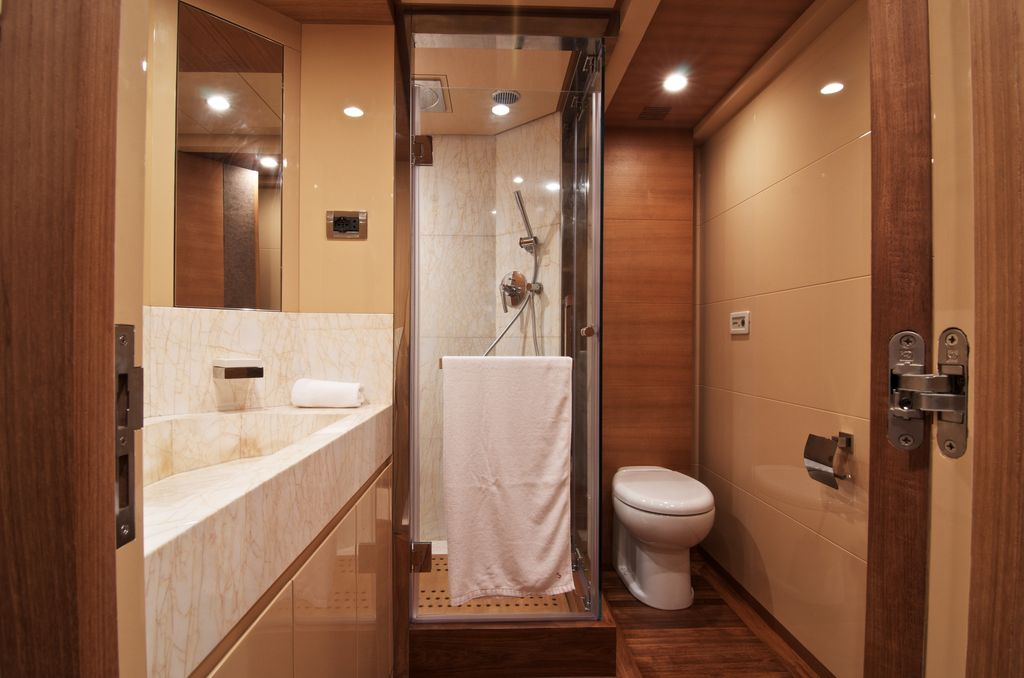 Contemporary 3/4 Bathroom with full backsplash, Standard height, flat door, can lights, Simple marble counters, Shower