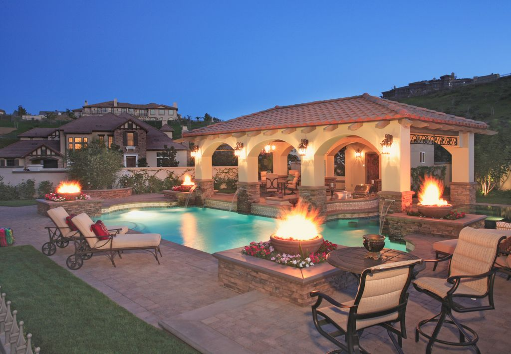 Mediterranean Swimming Pool with Fountain, Gazebo, Fire pit, exterior stone floors, Fence