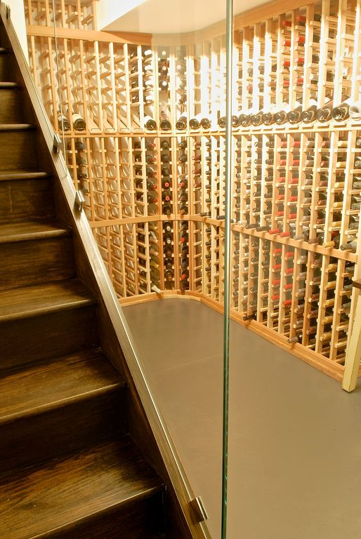 Contemporary Wine Cellar with Polished concrete floor, Concrete floors