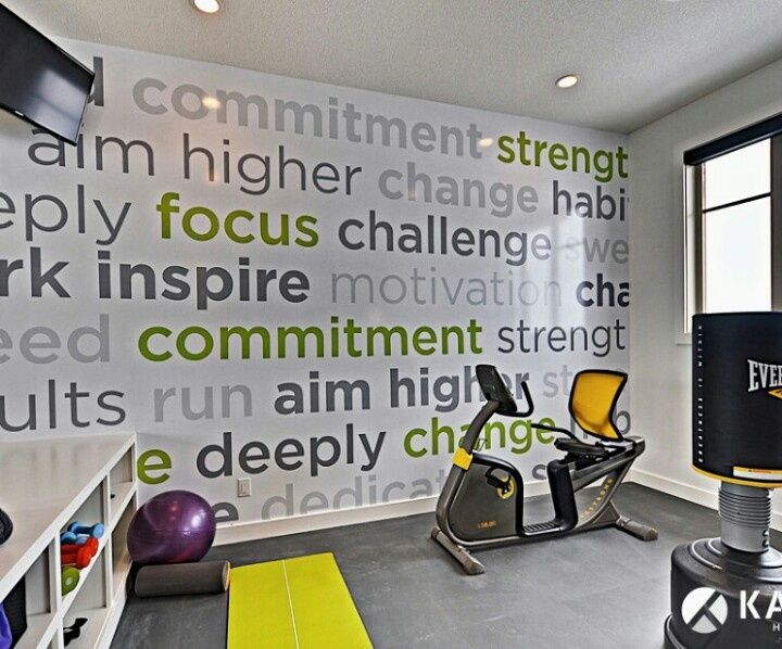 Contemporary Home Gym with interior wallpaper, Built-in bookshelf, Wall graphics, Concrete floors