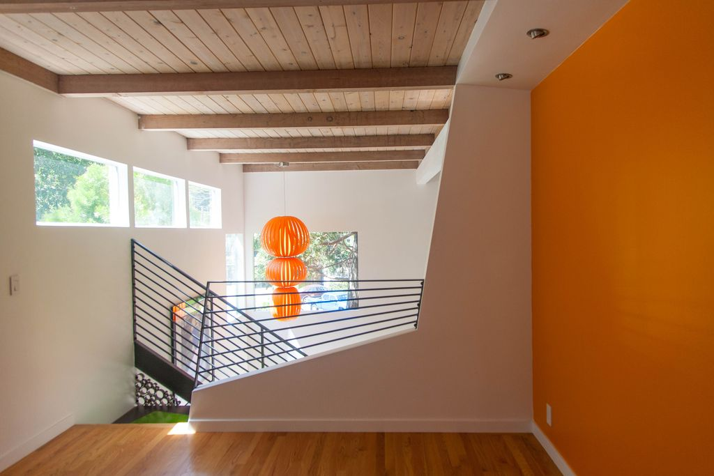 Modern Hallway with picture window, Exposed beam, Laminate floors, Standard height, can lights