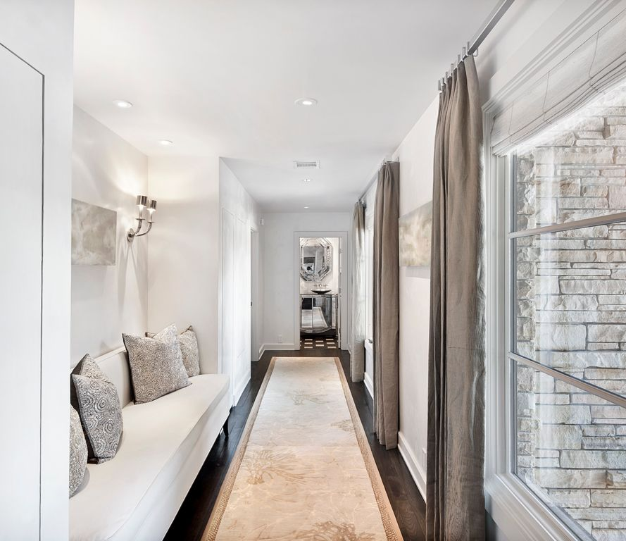 Contemporary Hallway with Wall sconce, Hardwood floors, Casement, Standard height, can lights