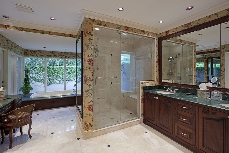 Traditional Master Bathroom with picture window, Complex marble counters, Shower, Double sink, simple granite floors, Bathtub