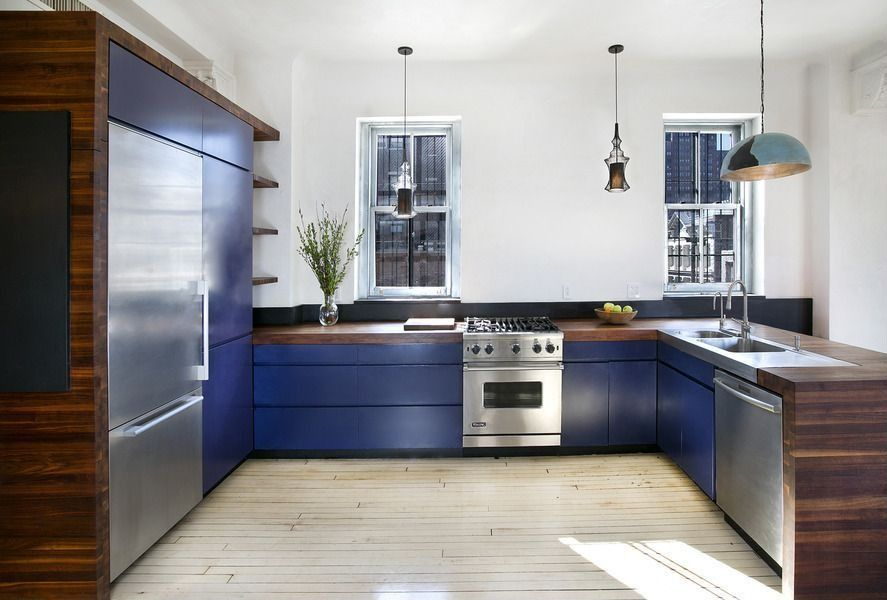 Contemporary Kitchen with Slate, U-shaped, gas range, European Cabinets, Wood counters, Multiple Refrigerators, dishwasher