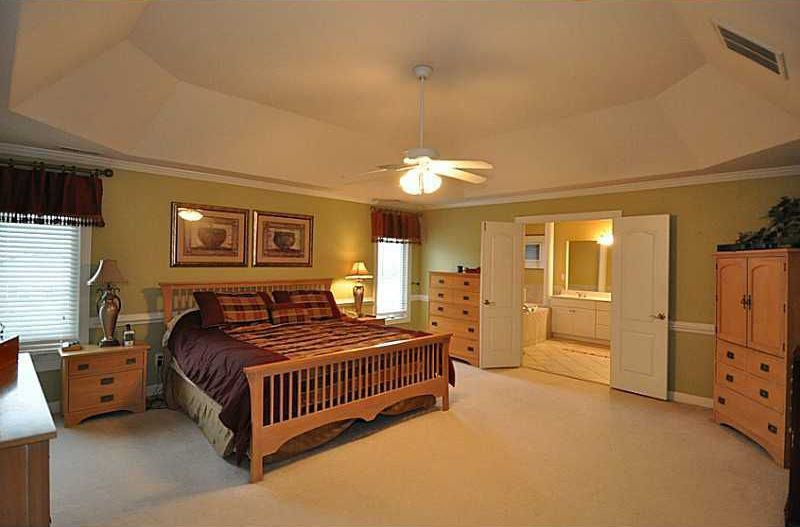 Craftsman Master Bedroom with French doors, Carpet, Crown molding, Chair rail, Ceiling fan