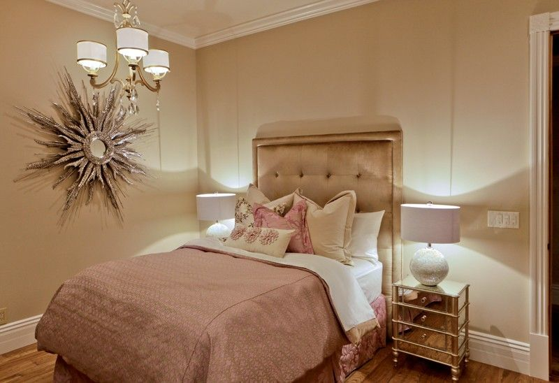 Art Deco Guest Bedroom with Crown molding, Chandelier, Standard height, Hardwood floors