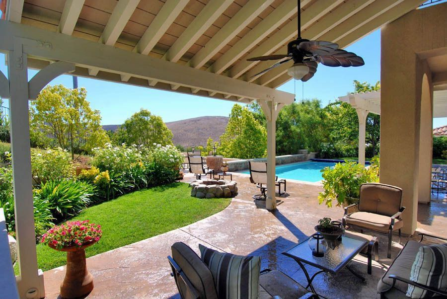 Traditional Patio with exterior concrete tile floors, Trellis, Fire pit, exterior tile floors