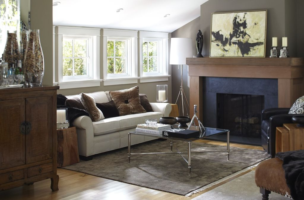 Contemporary Living Room with Standard height, Cement fireplace, Fireplace, can lights, Casement, Laminate floors