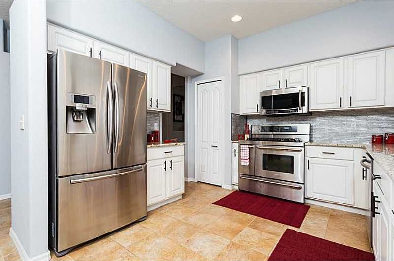 Traditional Kitchen with Paint, Standard height, limestone tile floors, full backsplash, specialty door, Raised panel