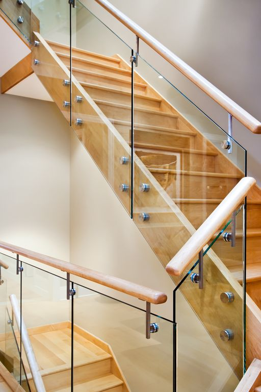 Contemporary Staircase with Hardwood floors, Standard height, curved staircase