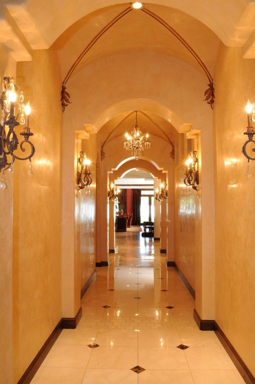 Traditional Hallway with Cathedral ceiling & Wall sconce Zillow Digs