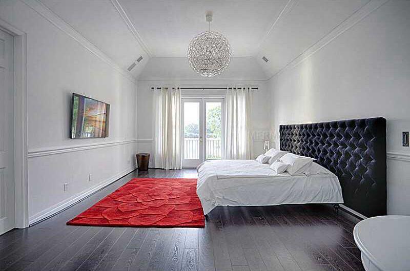 Modern Master Bedroom with Standard height, Crown molding, Hardwood floors, French doors, Chair rail, Chandelier