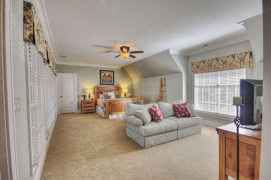 Traditional Master Bedroom with Casement, Standard height, specialty door, Crown molding, Carpet, Ceiling fan