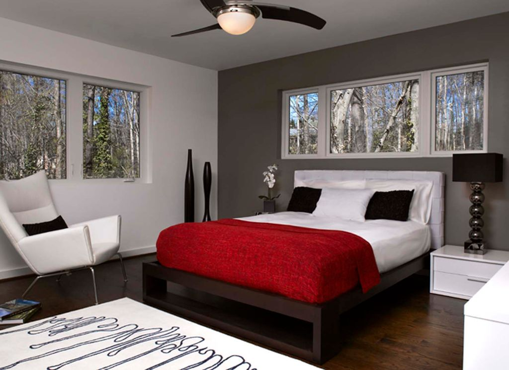 Modern Guest Bedroom with Standard height, Legacy home black chrome ball table lamp, Hardwood floors, Casement, Paint