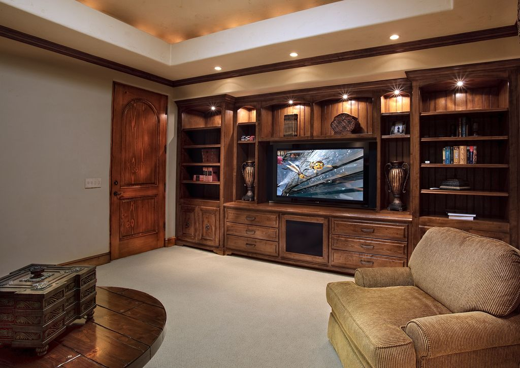 Country Library with Built-in bookshelf, Carpet, Crown molding, specialty door, can lights, Standard height